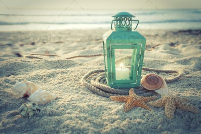 Lantern on a Tropical Beach at Sunrise