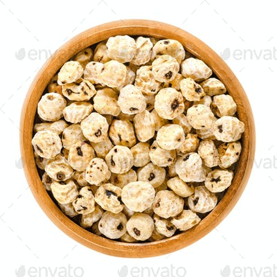Tiger nuts, earth almonds, dried, in wooden bowl
