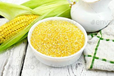 Corn grits in bowl on light board