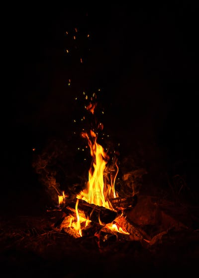 Fire burns at night in a tourist camp