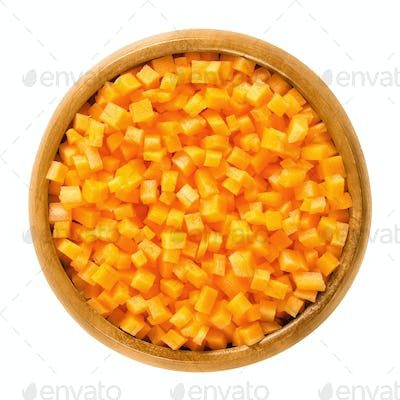Carrot cubes in wooden bowl over white