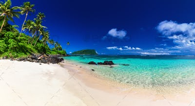 Panorama of Lalomanu beach on Samoa Island with coconut palm tre