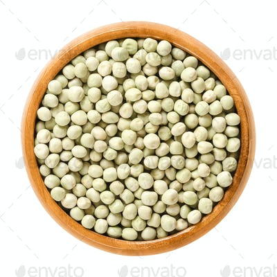 Dried green peas in wooden bowl
