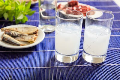 Two glasses of ouzo and appetizers
