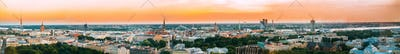 Riga, Latvia. Aerial View Panorama Cityscape At Sunset. TV Tower