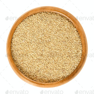 Amaranth grain in wooden bowl over white