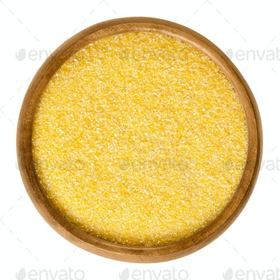 Cornmeal medium in wooden bowl over white