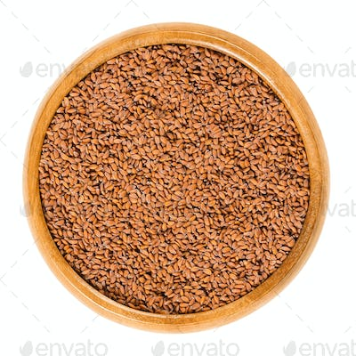 Garden cress seeds in wooden bowl over white