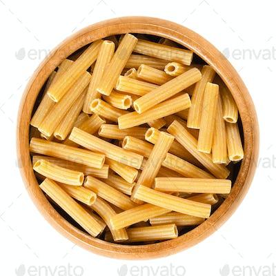 Chickpeas sedanini pasta in wooden bowl over white