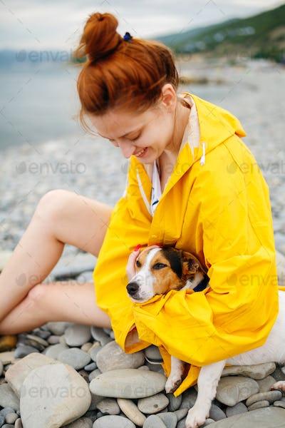 Girl with dog on beach