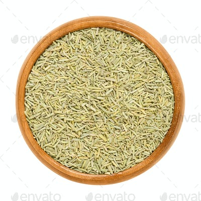 Rosemary dried in wooden bowl over white