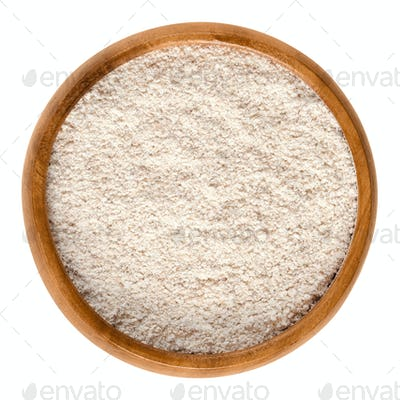 Whole-wheat flour, wholemeal flour in wooden bowl