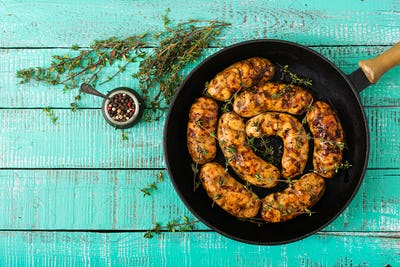 Dietary sausages from turkey fillet and mushrooms in pan