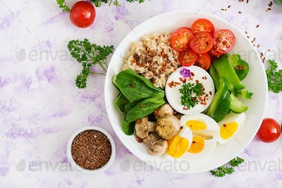 Oatmeal porridge, egg and fresh vegetables - tomatoes, spinach, paprika,  mushrooms
