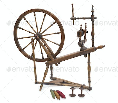 Antique Spinning Wheel with Bobbins Isolated on White Background