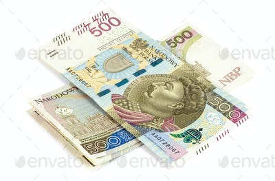 Heap of 500 pln banknotes on white background