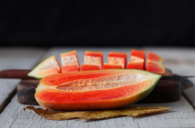 papaya sliced on wooden