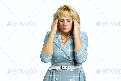Middle aged woman with terrible headache