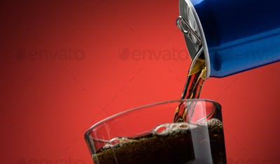 Pouring a soft drink in a glass