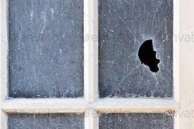 Broken pane of glass in an old window