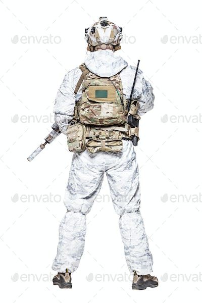 Special forces operator in winter camo clothes