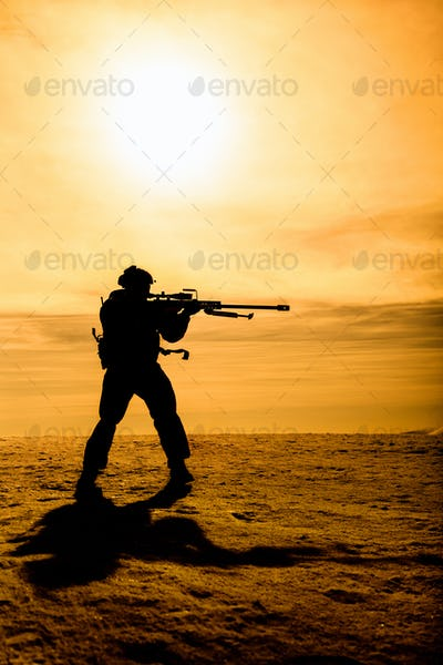 Silhouette of soldier with sniper rifle