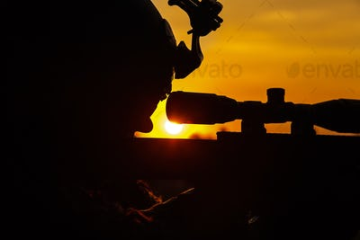 Army sniper on sunset