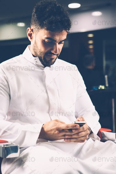 Man browsing phone in chair