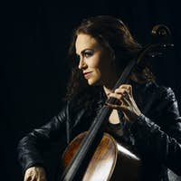 Attractive cello player playing her instrument