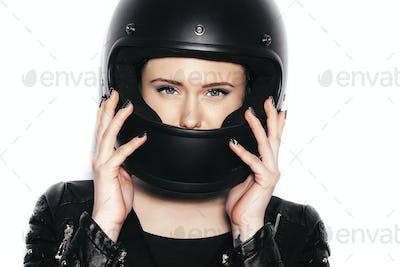 portrait of young beautiful woman in biker helmet