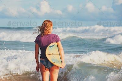 Surfer girl enjoying vacations