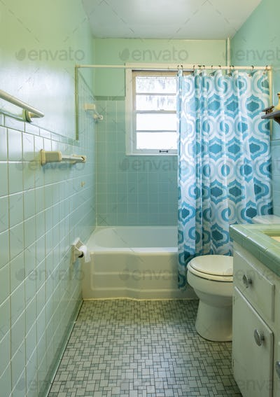 Simple dated 1950s bathroom with green tile.