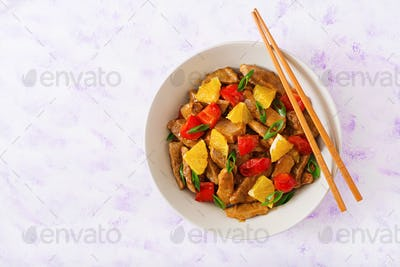 Veal fillet - stir fry with oranges and paprika in sweet and sour sauce