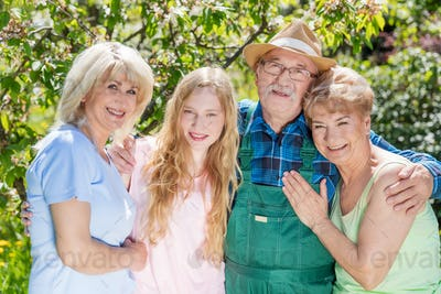 Family spending time together in a summer garden. Generations