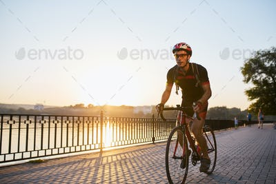 Young and energetic cyclist in the park