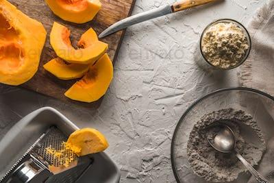 Pumpkin, flour on a white table for making pancakes