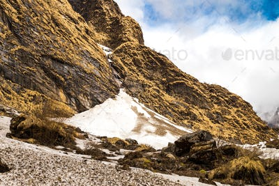 Glaciers on mountains valley on the trek path to mountains in Nepal