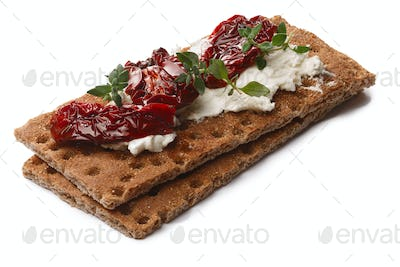 Bread crisps with dried tomato, cheese and thyme