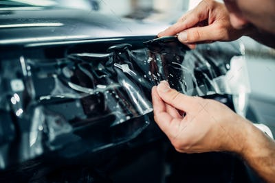 Specialist install car paint protection film