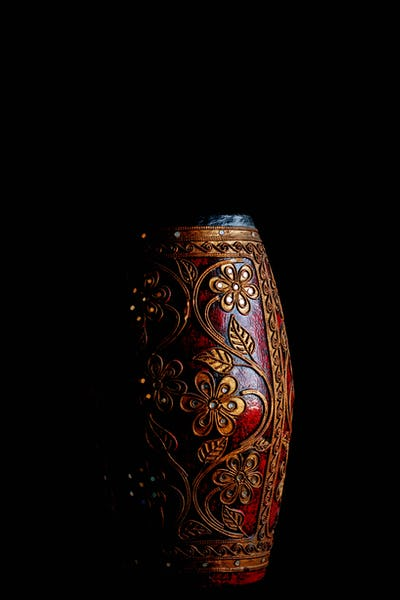 vase with a black background