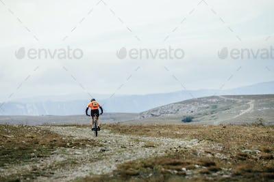 Mountainbiker on Cycle Rides on Mountain Trail