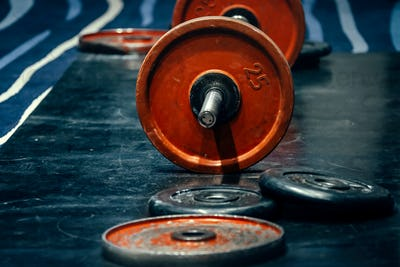 Barbell and discs in gym