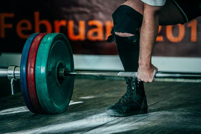 Male athlete deadlift in competition