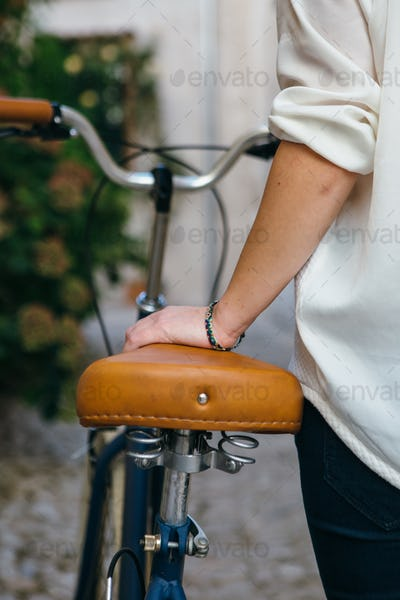 Crop female with bicycle