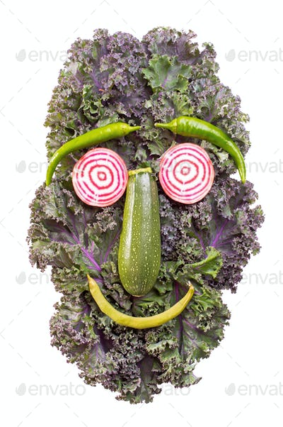 Funny face of vegetables isolated