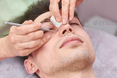 Cosmetician cleaning face close up