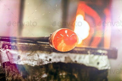 Glassblowing Piece and Furnace in Background
