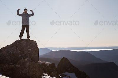 Victorious Woman Enjoying the Success of the Richardson Mountain