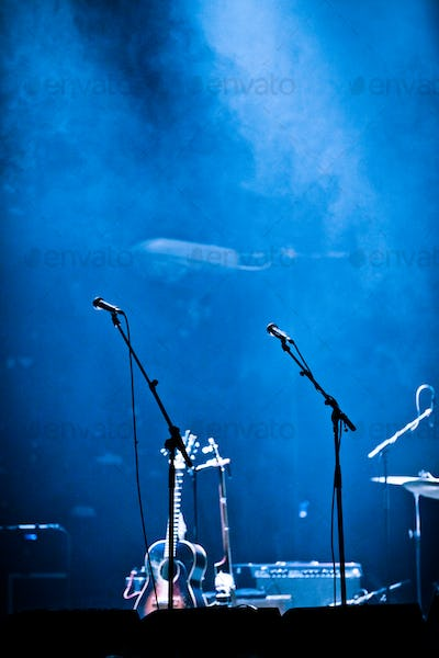 Empty Stage and Fog with Microphones and Guitar
