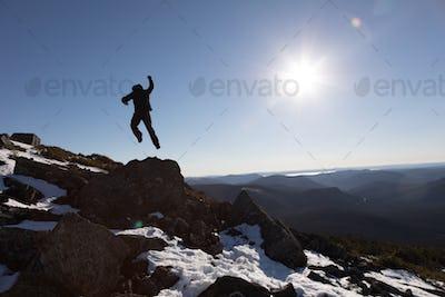 Victorious Man Enjoying the Success of the Richardson Mountain's